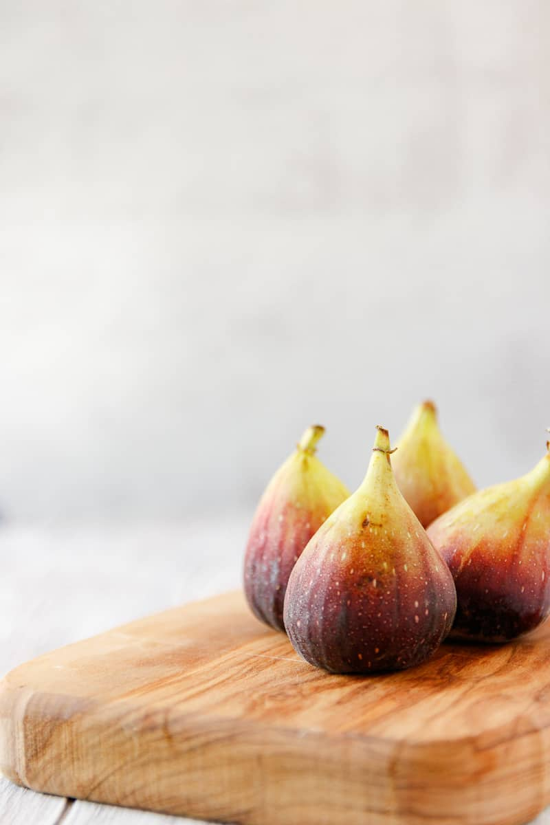 fresh figs on a wooden cutting board