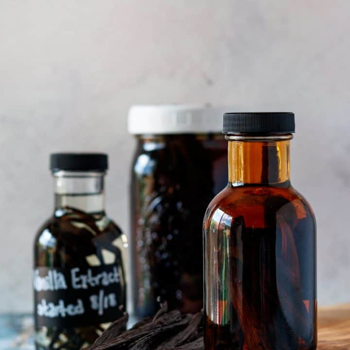 how to make vanilla extract - 3 extract bottles in different stages of preparation