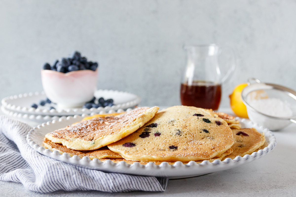 lemon blueberry pancakes on a plate with no toppings yet