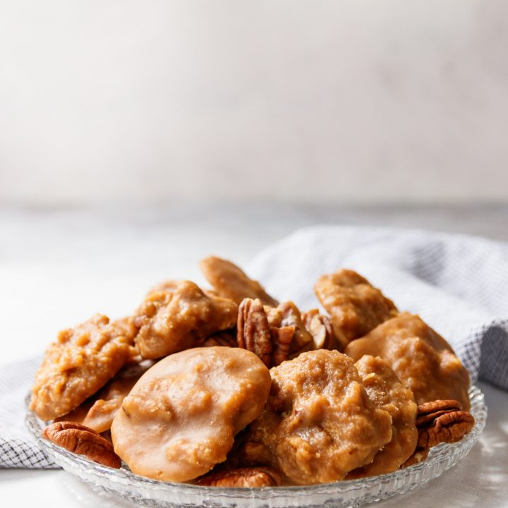 pumpkin pecan pralines on a plate light background and drop