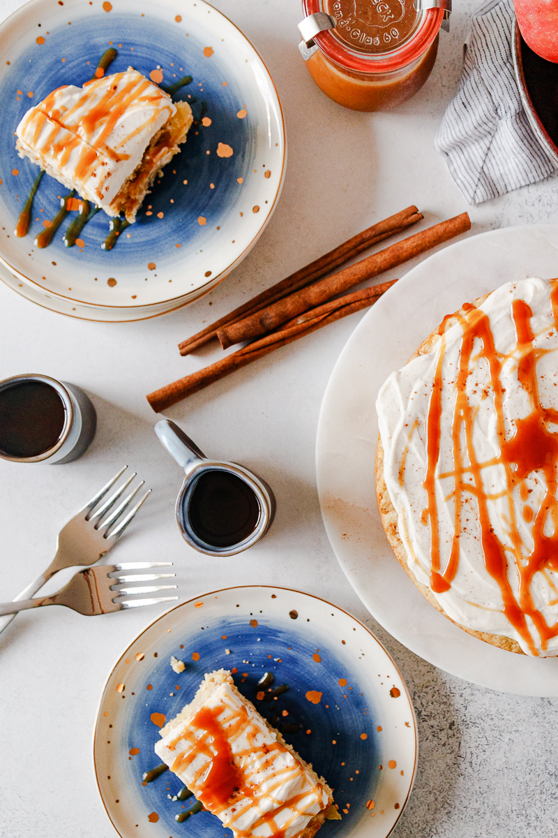 top view breakfast cake flatlay with espresso cups, cinnamon sticks, and sliced cake