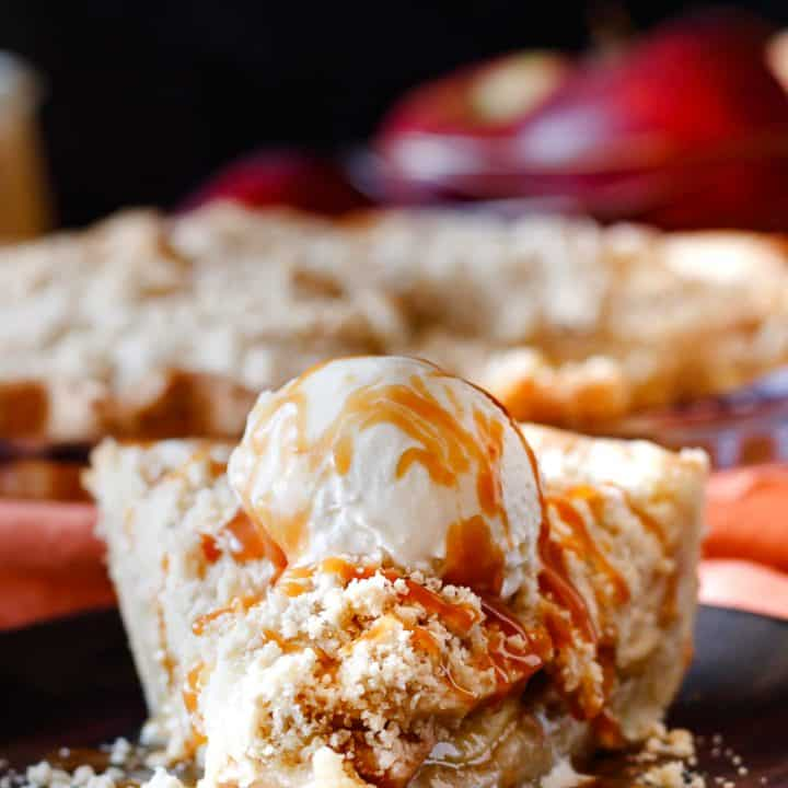 front view of a slice of pie with apple and caramel, shows slices in filling