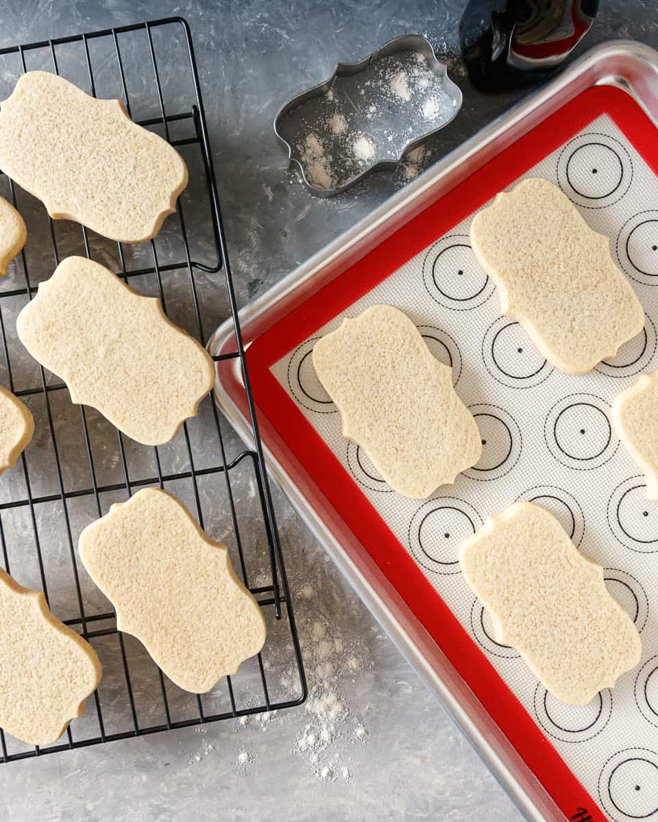 top view of the soft sugar cookies on a baking sheet and a wire rack