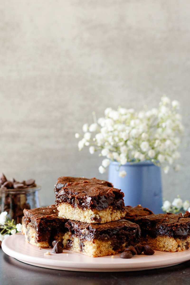 brookie bars with a small vase of baby's breath in the background