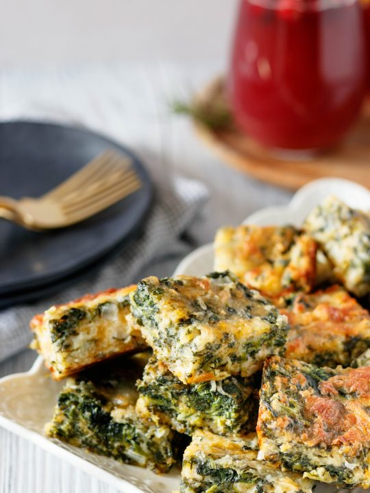 easy spinach squares piled on a plate