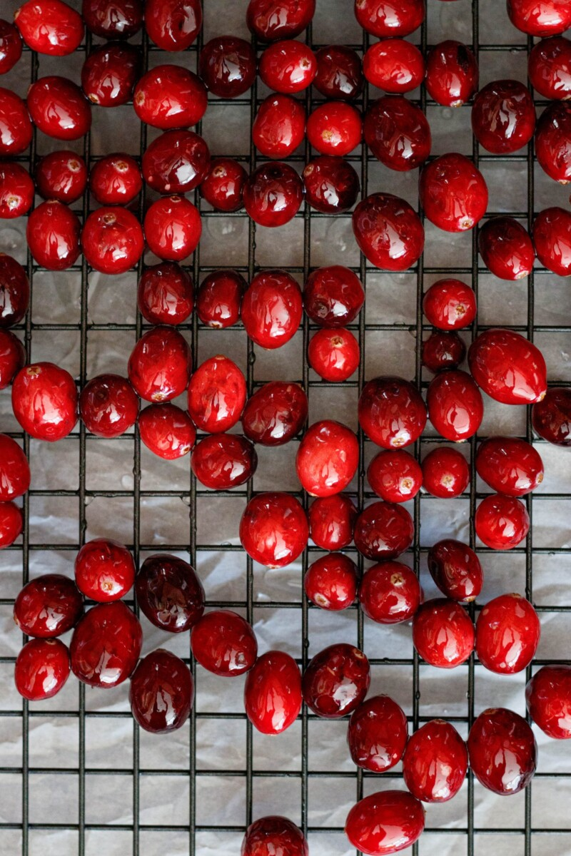 fresh cranberries on a grid drying rack