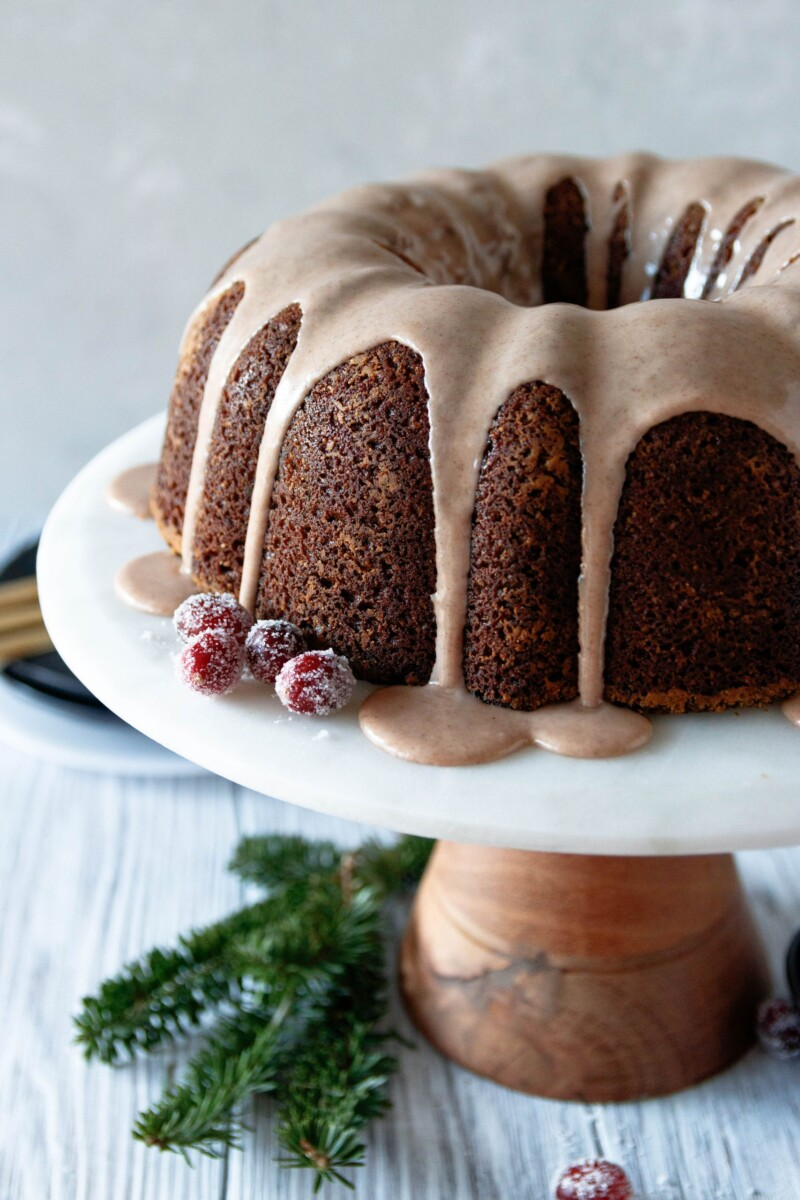 angled picture of the bundt cake to show the glaze and rich color