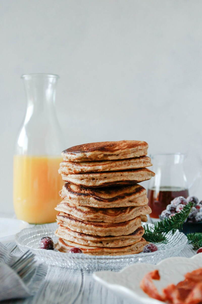 a big stack of fluffy eggnog pancakes ready to serve