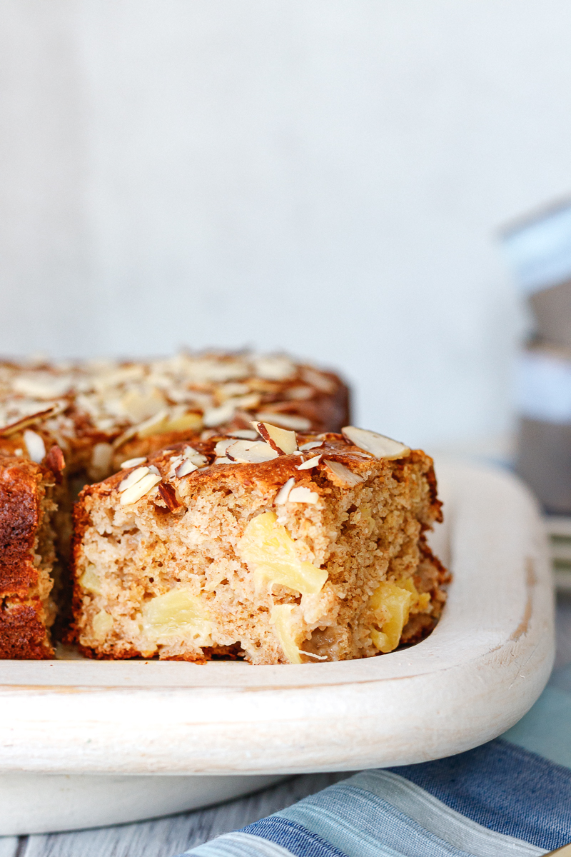 close up of a slice of pineapple coffee cake