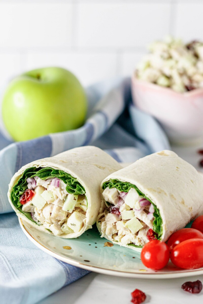 plated chicken salad wraps ready to serve with cherry tomatoes on the side