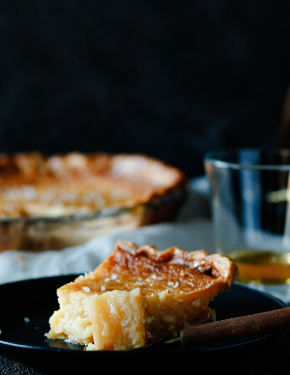 close up of the slice of salted whiskey honey pie with a bite sitting on a spoon