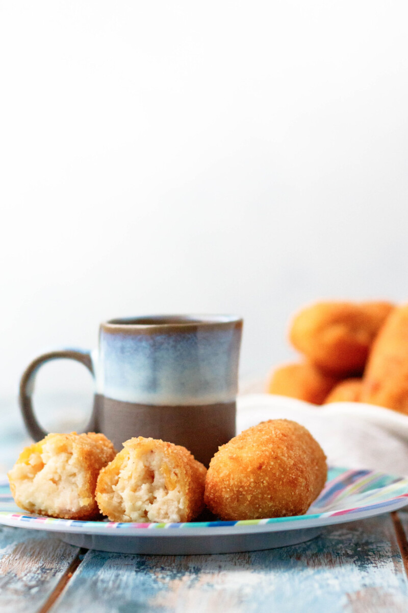 straight on view of the plated croquetas with coffee