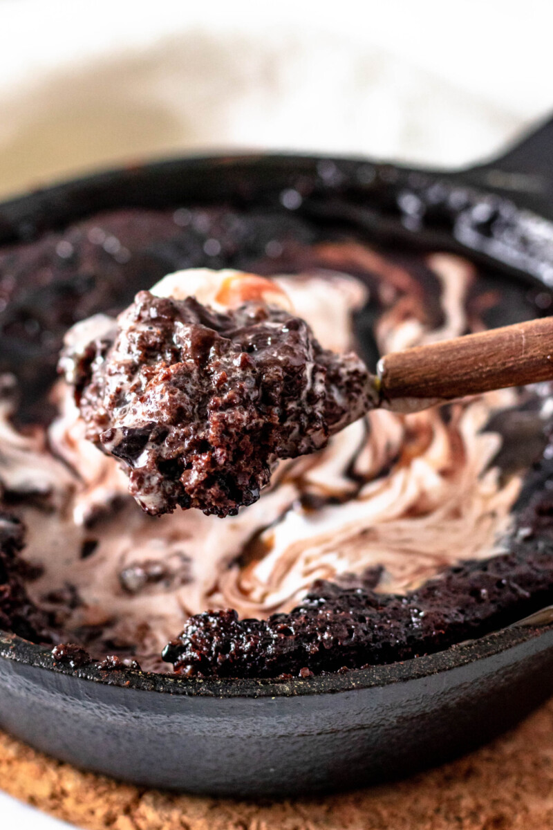 close up of a spoonful of cake to show the ooey gooey texture in all its fudgy deliciousness