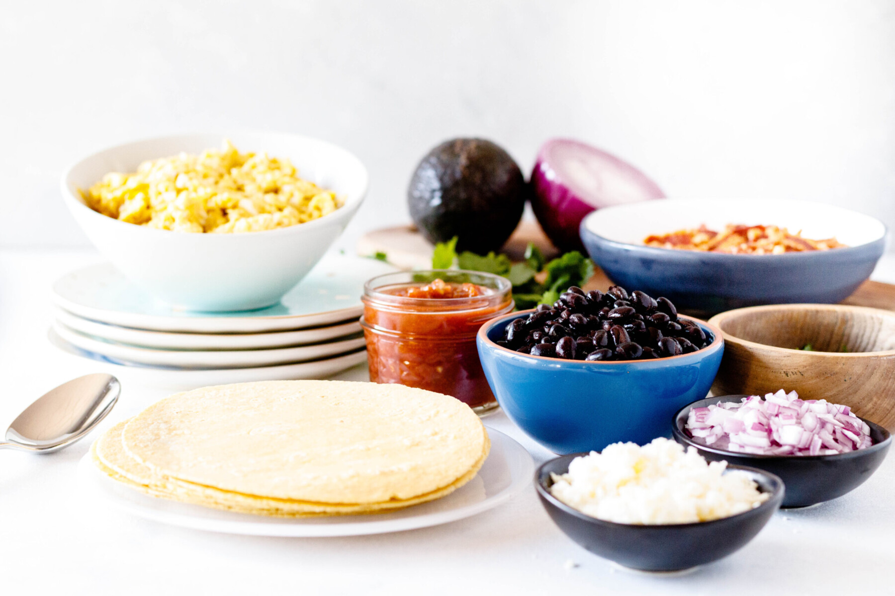 horizontal picture of a taco bar on the photo set, light background