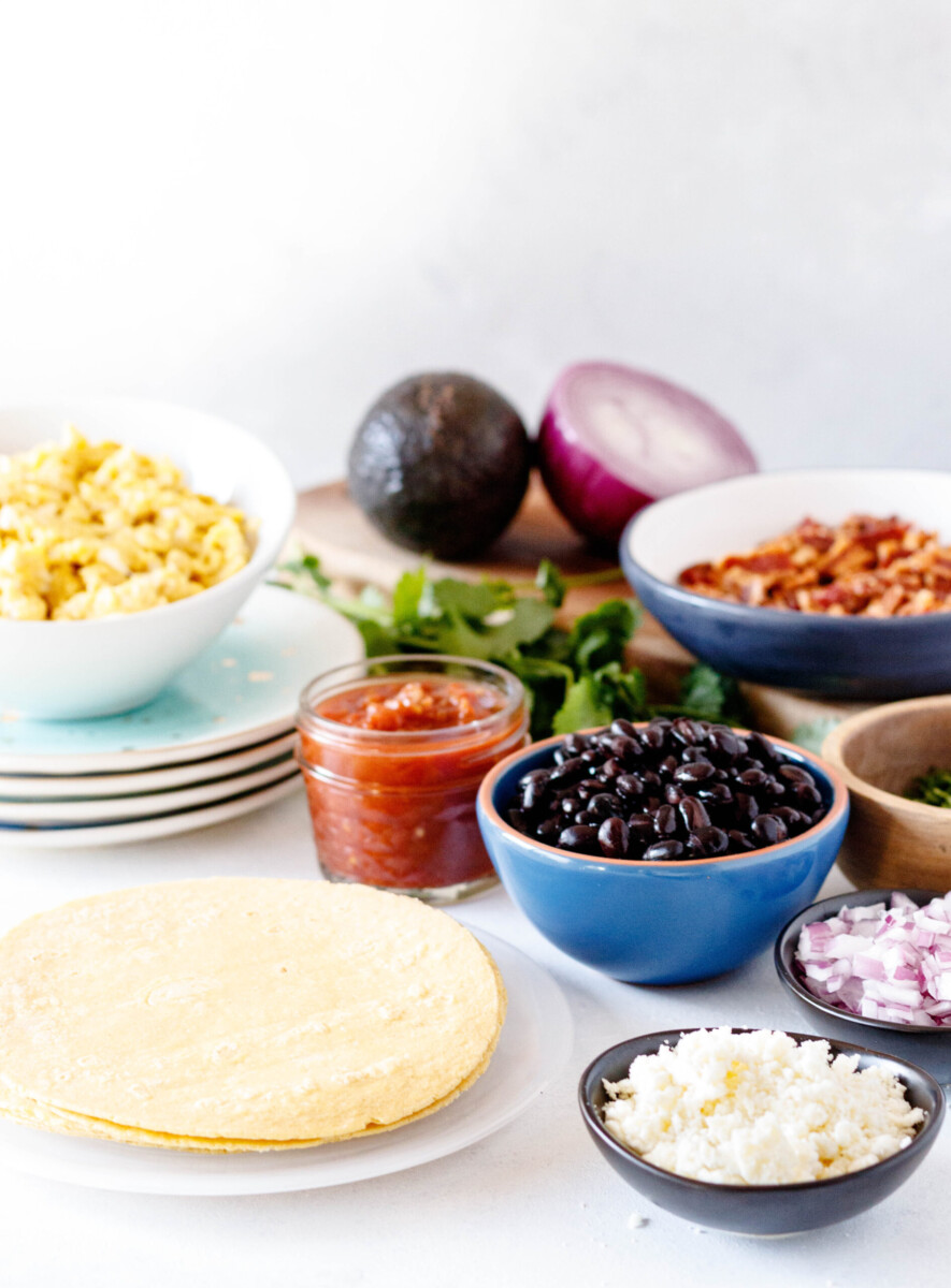 a photo of the breakfast taco bar with the angled bowl of scrambled eggs easily visible so you can see the fluffy texture