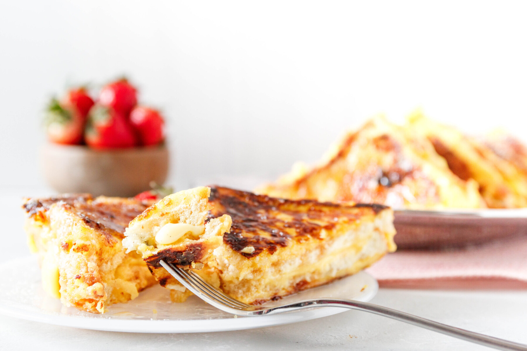 bite of cut french toast on a fork