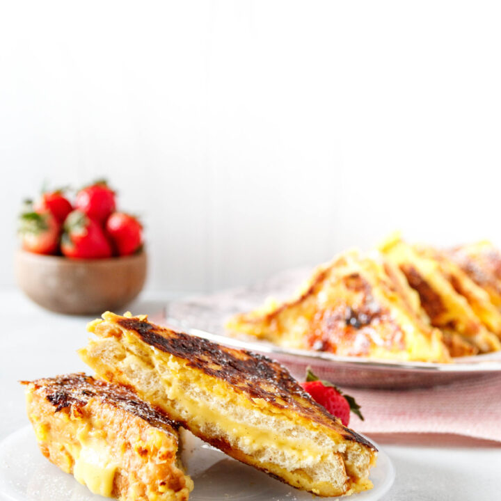 sliced creme brulee french toast on a plate, ready to serve