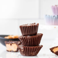 stacked chocolate cashew butter cups with a sprinkle of coarse salt
