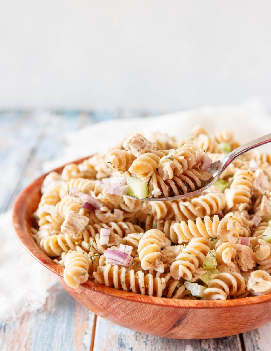 creamy lemon chicken pasta salad on a serving spoon