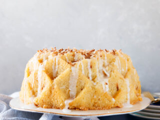 plated toasted coconut rum cake on a plate ready to serve