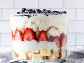 assembled summer berry trifle in a large trifle dish