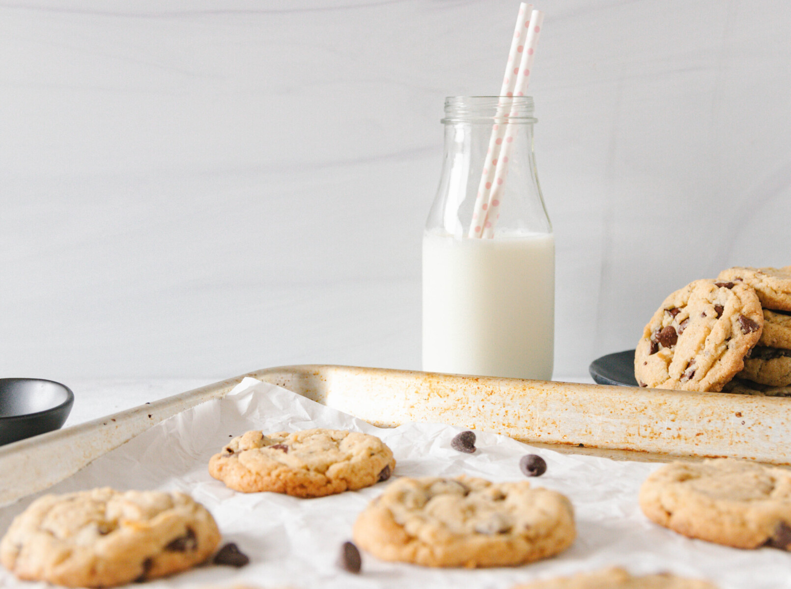 horizontal image of the bake chocolate chip cookies on a baking sheet