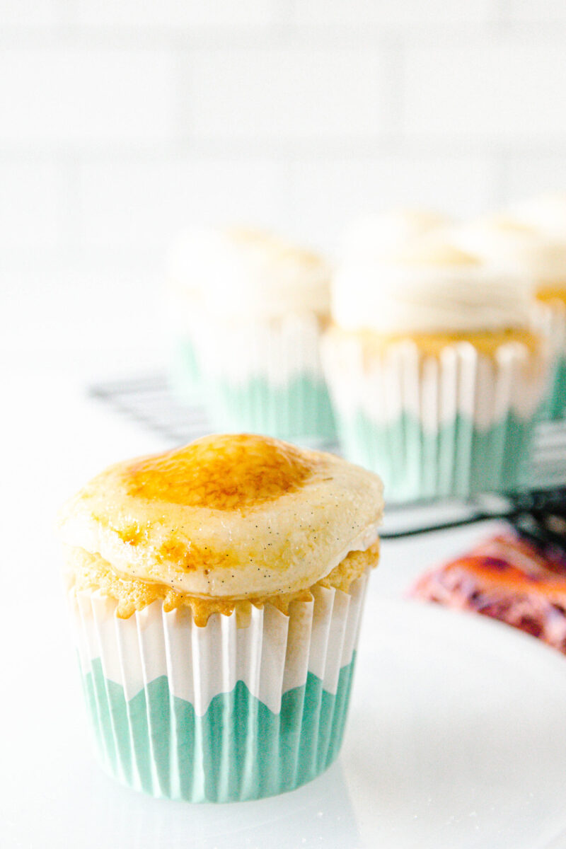 creme brulee cupcake with a torched sugar topping on a plate