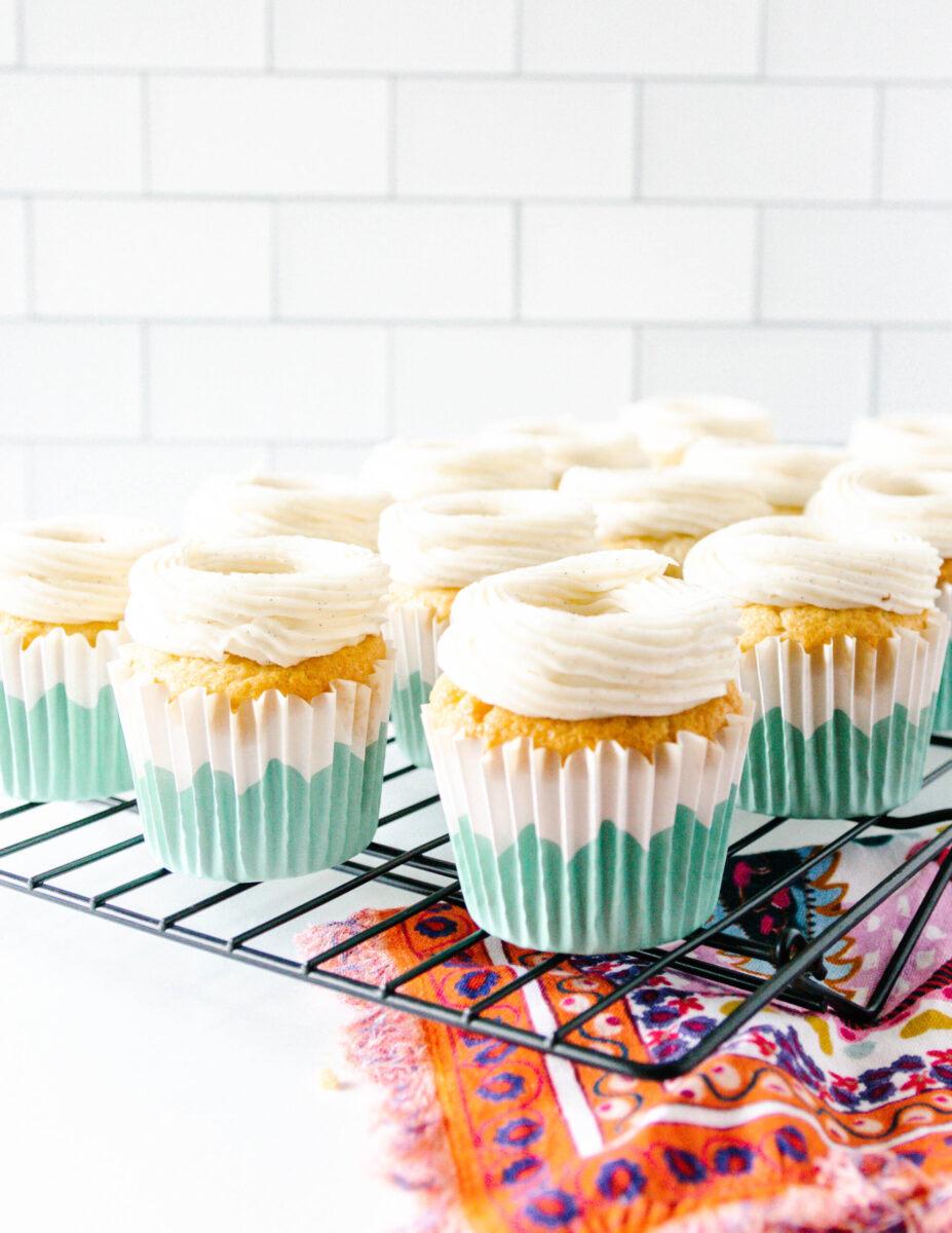 unfilled cupcakes with a ring of frosting around the cored center. This is to demonstrate one way to frost a creme brulee cupcake